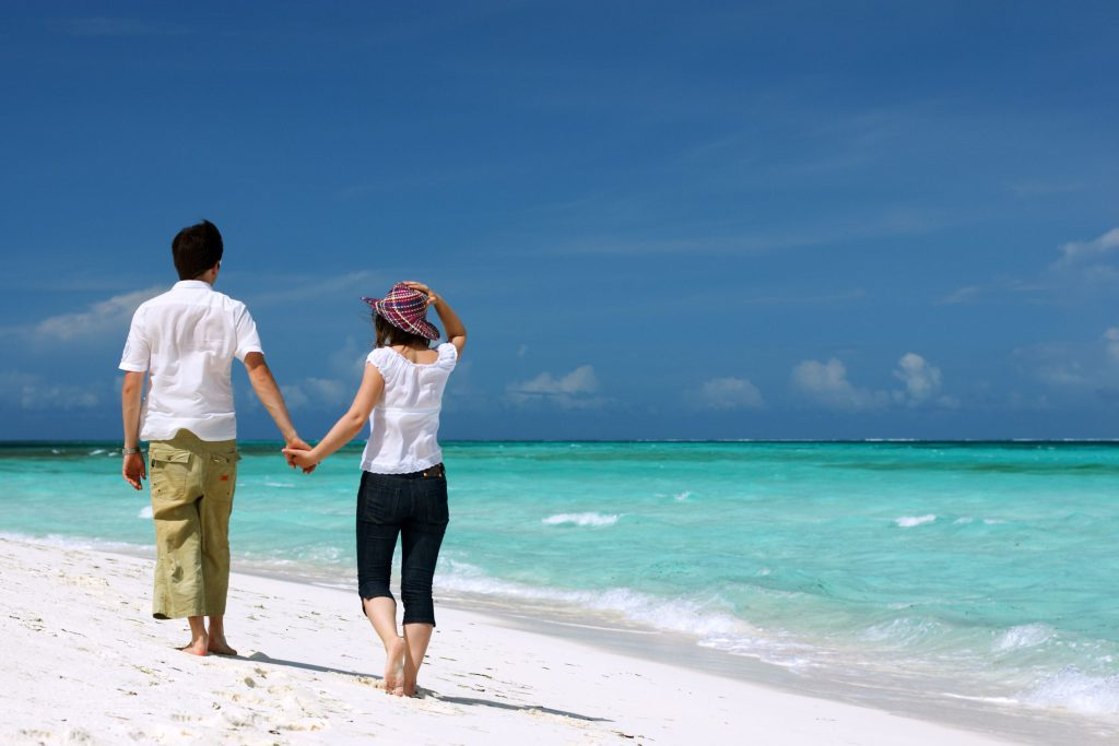 http://www.dreamstime.com/royalty-free-stock-photos-young-couple-beach-image2920658