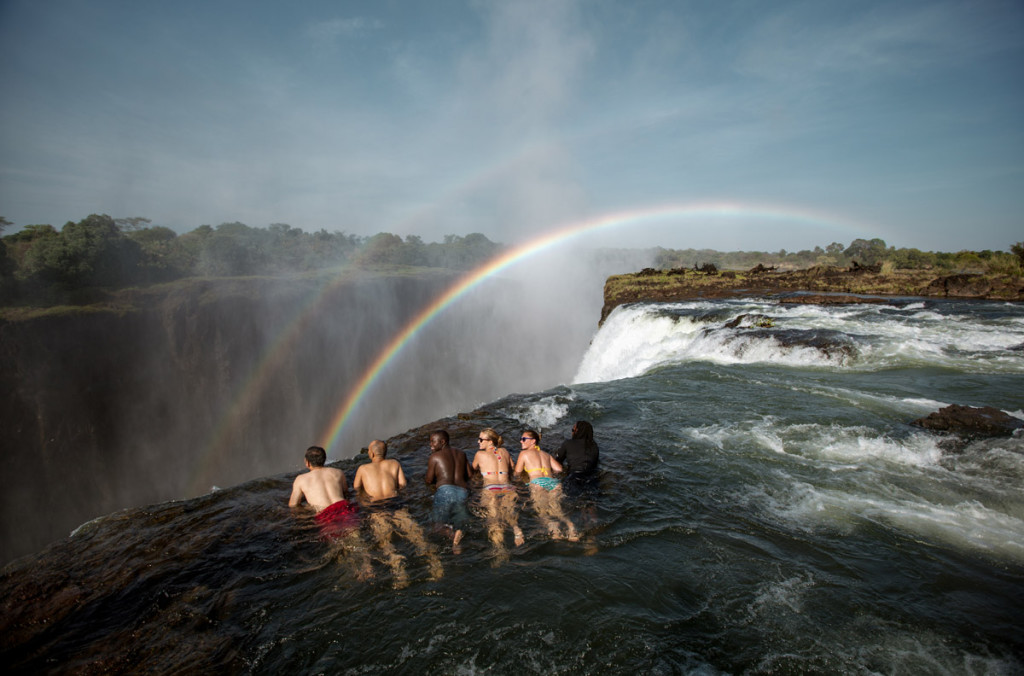 Looking over the edge of the Devil's Pool (Zambia Tourism)