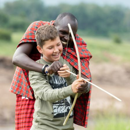 Learning how to shoot a bow and arrow at Governors Camp in the Masai Mara