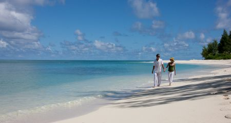 Couple On A Beach In Seychelles