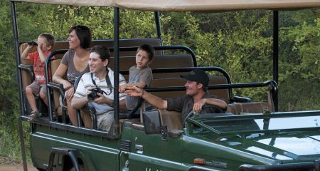 Young family on a safari game drive.